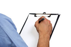 Delivery man's hand signing document on clipboard Royalty Free Stock Photos