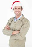 Delivery man in Santa hat standing arms crossed Stock Images