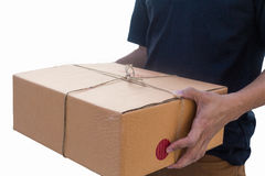 Delivery man service sent a package box. isolated white backgrou. Nd Stock Photos