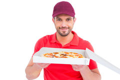 Delivery man showing fresh pizza Royalty Free Stock Image