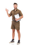 Delivery man showing ok sign Stock Image