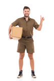 Delivery man showing thumb up Royalty Free Stock Photography