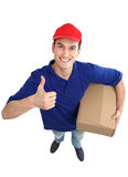 Delivery man showing thumbs up Royalty Free Stock Photography