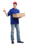 Delivery man showing thumbs up Stock Image