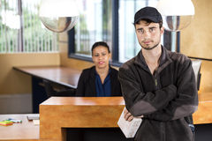 Delivery Man Standing At Office Reception Stock Images