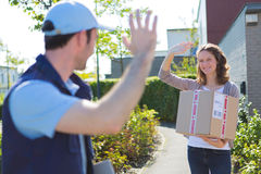 Delivery man succeed during his delivery Stock Photos