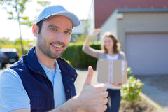 Delivery man succeed during his delivery Stock Photography