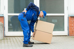 Delivery Man Suffering From Backpain Stock Photos