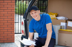 Delivery man taking break from work Royalty Free Stock Photos