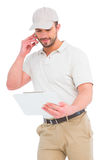 Delivery man talking on mobile phone Royalty Free Stock Images