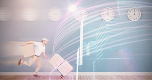 Delivery man with trolley of boxes running Royalty Free Stock Photos
