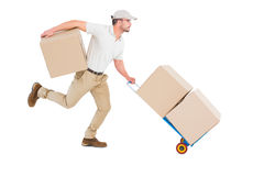 Delivery man with trolley of boxes running Stock Photography