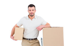 Delivery man with trolley of boxes Stock Images
