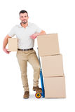 Delivery man with trolley of boxes Stock Photos