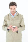 Delivery man using smart phone Royalty Free Stock Images