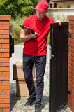 Delivery man waiting for customer Stock Photography