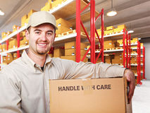 Delivery man in warehouse. Delivery man with parcel in warehouse 3d background royalty free stock image