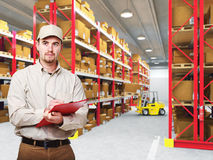 Delivery man in warehouse Royalty Free Stock Photos