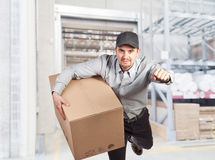 Delivery man in warehouse Stock Images