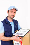 Delivery man on a white background Royalty Free Stock Photo