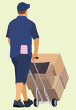 Delivery Man. White or Caucasian Delivery Man Pushing Hand truck Viewed from Behind Royalty Free Stock Photography