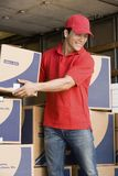 Delivery Man At Work Royalty Free Stock Photography