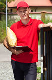 Delivery man working outdoors Stock Images