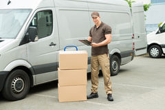 Delivery Man Writing On Clipboard Stock Photography