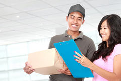 Delivery man and young woman Stock Image