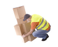 Delivery men  bending down near carton boxes Stock Photos