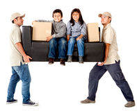 Delivery men carrying a couch Stock Photos
