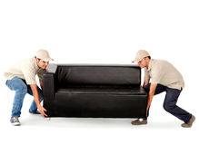 Delivery men carrying a sofa Royalty Free Stock Images