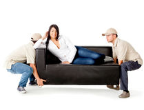 Delivery men carrying a sofa Stock Images