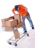 Delivery men thrusts shopping cart Stock Photos