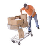 Delivery men thrusts shopping cart Stock Photo