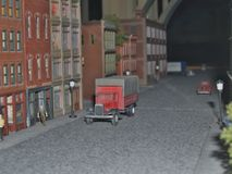 Delivery!. A miniature delivery truck waits outside its stop in an S gauge model train layout Stock Photography