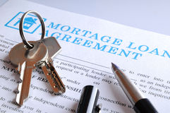 Delivery of the mortgage contract and keys closeup Stock Photo