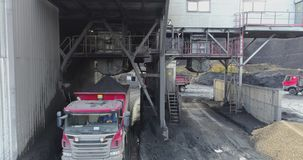 Aerial footage of big red truck in a career of mining. Delivery by the motor transport from a pit. Aerial footage stock video