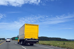 Delivery Moving Truck. Bright yellow-orange delivery moving truck under blue sky stock photos
