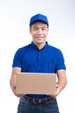 Delivery Person. Asian postman with parcel box. Postal delivery Royalty Free Stock Photography