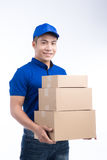 Delivery Person. Asian postman with parcel box. Postal delivery Royalty Free Stock Photos