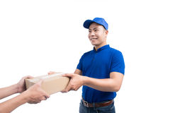Delivery Person. Asian postman with parcel box. Postal delivery Royalty Free Stock Images
