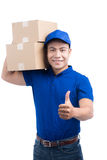 Delivery Person. Asian postman with parcel box thumps up. Royalty Free Stock Images