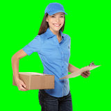 Delivery person delivering package. S holding clipboard and package smiling happy in blue uniform. Beautiful young Caucasian Chinese Asian female courier Stock Image