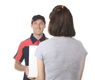 Delivery person delivering packages Royalty Free Stock Photos