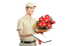 A delivery person holding a beautiful bouquet Stock Image