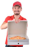 Delivery. Pizza man. Cheerful young deliveryman holding a pizza box while isolated on white Stock Photos
