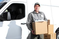 Delivery postal service man. Happy professional shipping courier. Delivery postal service Royalty Free Stock Photos