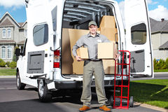 Delivery postal service man. Happy professional shipping courier. Delivery postal service Stock Photography