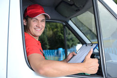 Delivery. Postal service. Delivery of a package through a delivery service Royalty Free Stock Photos